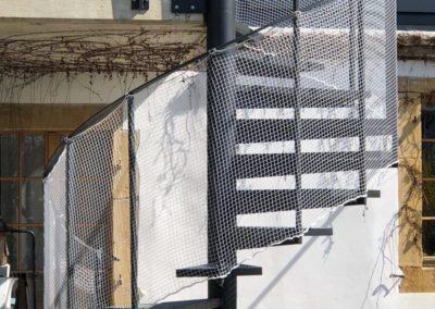 Pose d'un filet garde-corps sur escalier Hélicoïdale à Neuchâtel